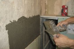 як покласти плитку на стіну