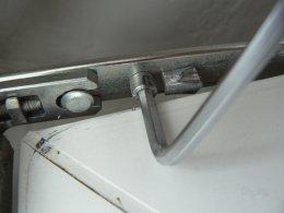 Регулювання на притиск механізмом на ножицях